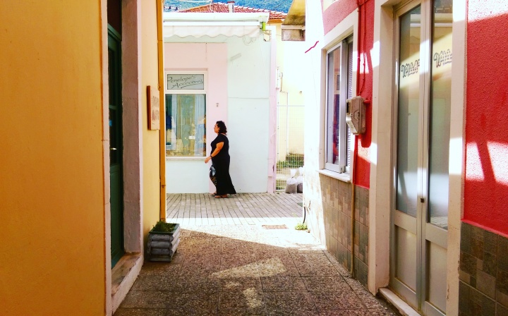 lady-streets-greece-colourful-houses