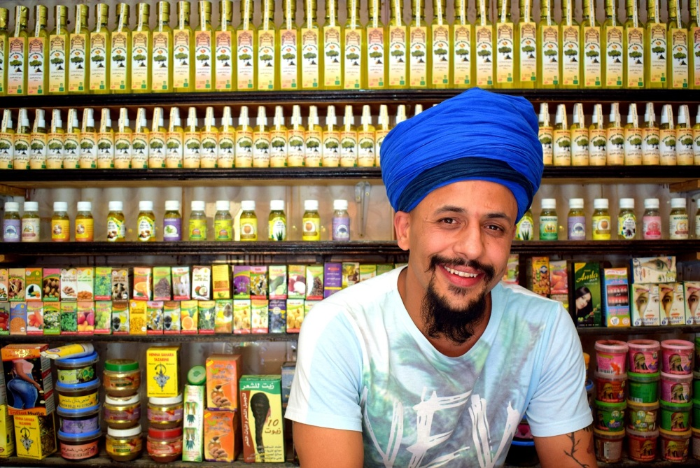 moroccan essential oils and a man smiling by ieva kambarovaite