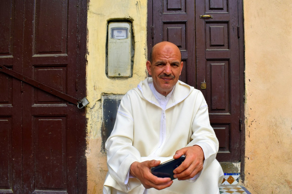 moroccan man in white by ieva kambarovaite