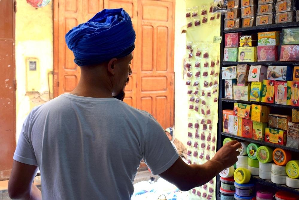 salesman in morocco fez old town by ieva kambarovaite
